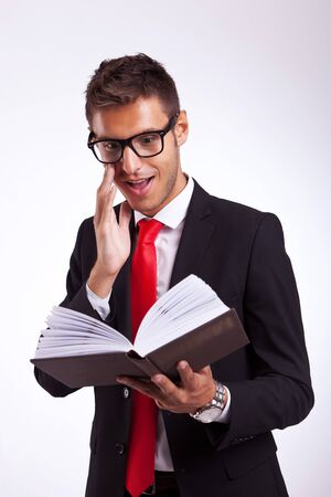 young business man being excited by the book he is reading Stock Photo - 15500200