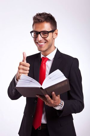 young business man reading about success in a good book Stock Photo - 15500191