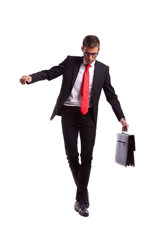 precipitate: Business man holding a briefcase balancing and walking forward on an imaginary rope