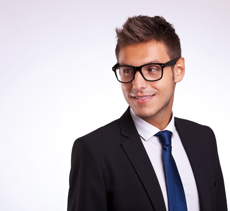 face side: Business man wearing glasses  looking to the side