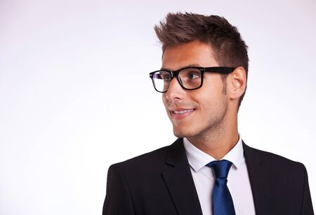 Handsome young student looking to his side Stock Photo - 15500255