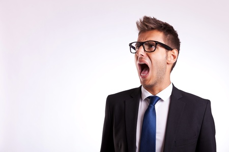 young business man or student screaming to his side  photo
