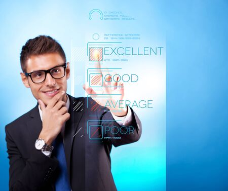 Young business man pushing imaginary digital buttons. Cool man with glasses.  Stock Photo - 15333373