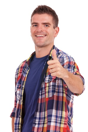 Portrait of a casual young man, thumbs up over white background Stock Photo - 15333355