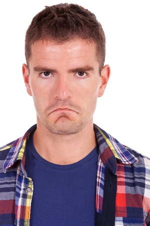 serious face: close up portrait of an upset young man looking at camera white background