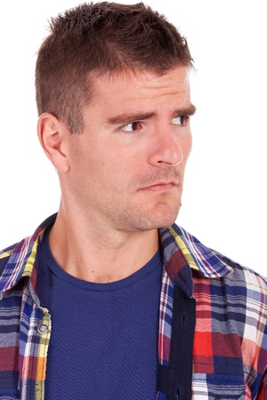 suspiciously: picture of a young casual man looking suspiciously to a side of the camera. on white Stock Photo