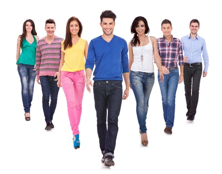 and leader: Large group of friends, young casual people,  walking together and looking at their future isolated on white background