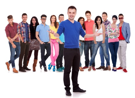 handsome man welcoming to a young casual group of people Stock Photo - 15333374