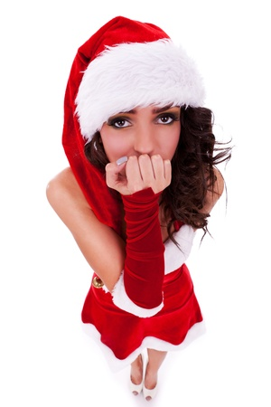 closeup picture of a beautiful young woman in christmas clothes looking scared or curious into the camera, isolated on white Stock Photo - 15618126