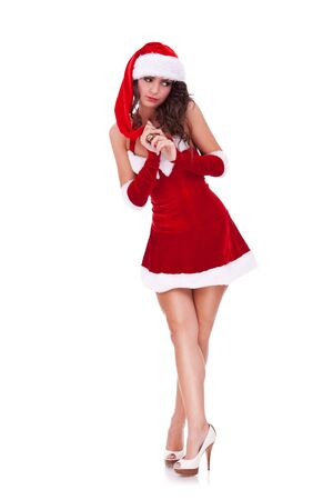 sexy costume: full length portrait of a beautiful young woman in christmas costume, looking innocently away from camera isolated on white background  Stock Photo