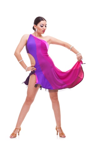 cha: gorgeous young salsa woman dancer holding her dress and looking down arrogantly Stock Photo
