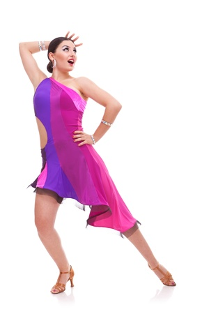 cha: young woman salsa dancer in a beautiful dance pose with hand behind head and looking upwards