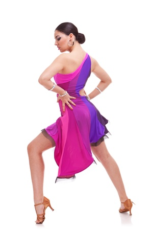 full length picture of a gorgeous salsa woman dancer posing with hands on hips