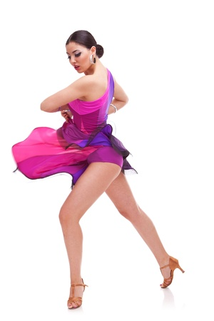 angelic salsa dancer reveals her long legs during a spin in the dance Stock Photo