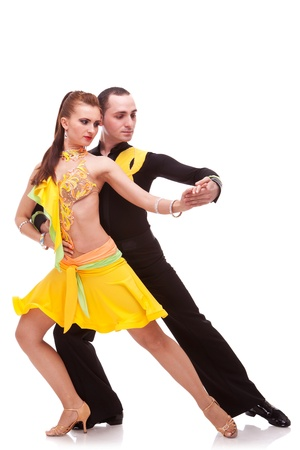 rumba: beautiful salsa dancing couple in the active ballroom dance in a splendid dance pose Stock Photo