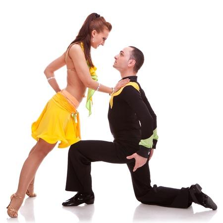 salsa woman dancer leaning on her kneeling dance partner photo