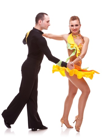 demonstration of dance from a salsa dance couple. on white photo