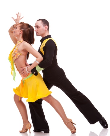 tangoing: salsa male dancer standing behind woman dancer during a salsa dance Stock Photo