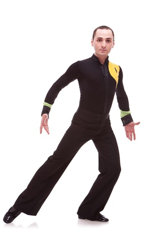 salsa male dancer posing in a semi lunge on white backgroung photo