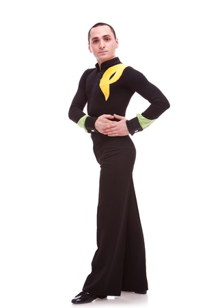 latin dance:  full body of a man salsa dancer looking at the camera with his hands on one hip isolated on white .