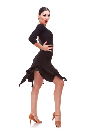 Young woman performing salsa dance with passion, isolated on white background