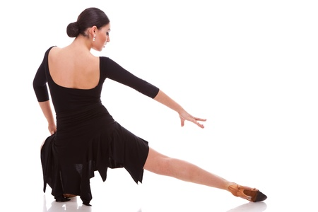 back view of a beautiful salsa dancer posing in a lunge dance move photo