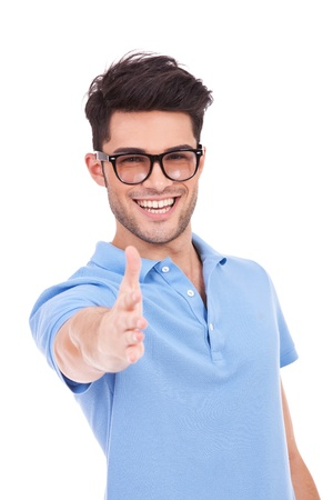 man with glasses: Smiling casual young man putting out his hand for shaking over white background Stock Photo