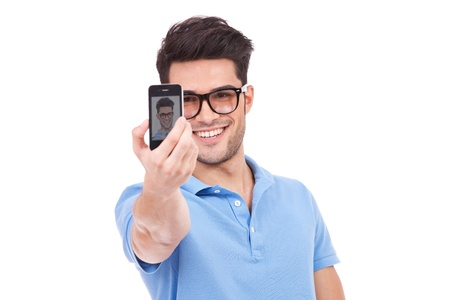 picture person: Sexy young casual man taking a photo of himself with his phone and smiling