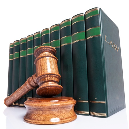 Judges wooden gavel and law books on white background photo