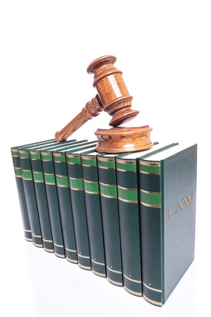 wooden judge gavel and sound block on top of a stack of books Stock Photo - 15736763