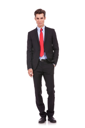 certitude: Confident modern business man with hand in pocket isolated on white