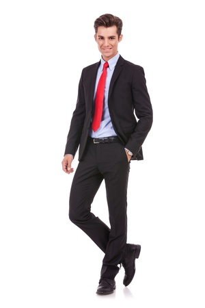 Full length of a handsome business man standing with hand in pocket against white , looking at the camera Stock Photo - 15719672