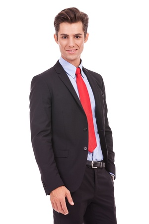 Portrait of a smiling confident business man standing with his hands in the pockets. Stock Photo - 15719675
