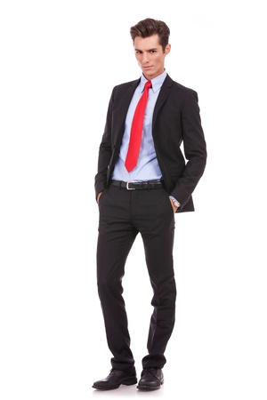 Proud business owner poses for a serious portrait on white background. Full body picture of a serious young business man looking at the camera Stock Photo - 15719665