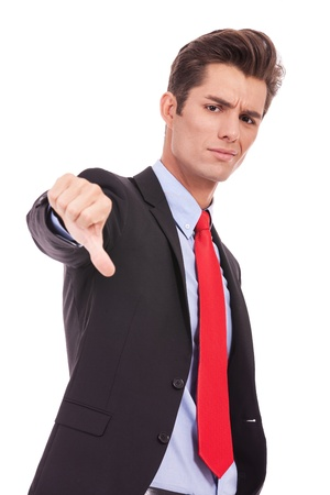 delusion: sisappointed young business man with thumb down  Stock Photo