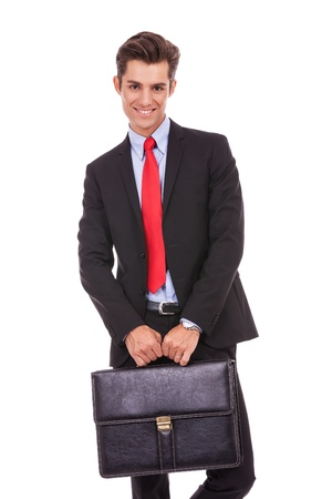 smiling business man with a suitcase, looking at the camera Stock Photo - 15738308