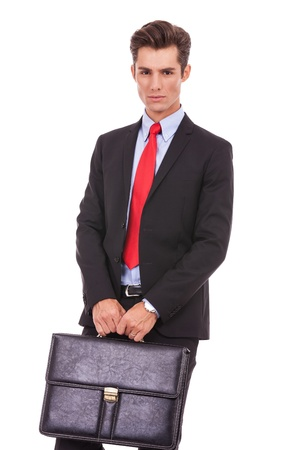 brief case: fashionable business man holding a briefcase, looking serious, on white background Stock Photo