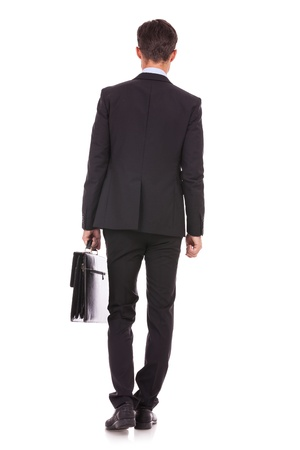 back view of a business man standing and holding a briefcase , looking away Stock Photo - 15738094
