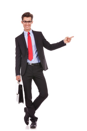 show case: young business man  pointing his finger to his left side, while holding a briefcase