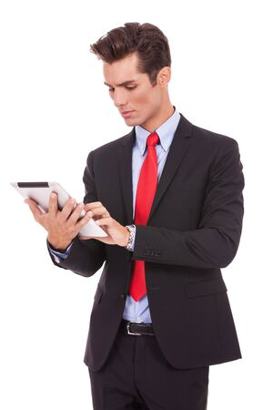 young business man working on his tablet pad on white background photo