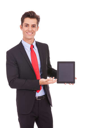 touch pad: smiling business man showing you his tablet pad on white background