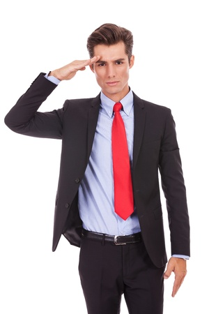 Salute: Business man gives military salute isolated on white background . military businessman saluting