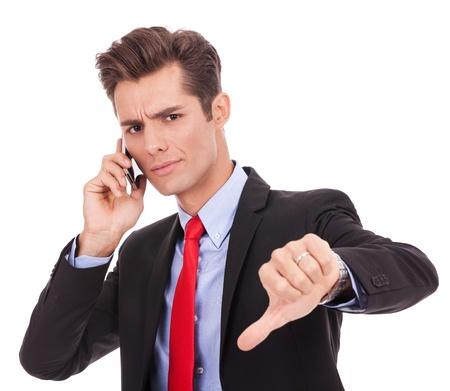 disapproving: Uomo d'affari con le cattive notizie sulla sua disapprovazione cellulare. risposta negativa Archivio Fotografico