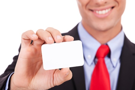 Business man handing a blank business card over white background Stock Photo - 15738223