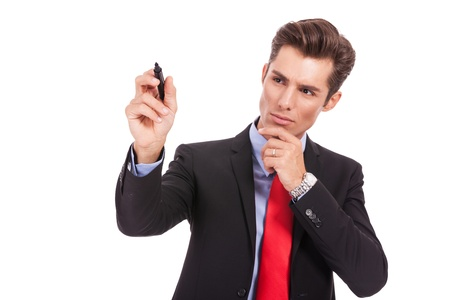 pensive business man is writing something with his marker on white background Stock Photo - 15738184
