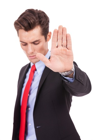 serious business man showing stop gesture on white background photo