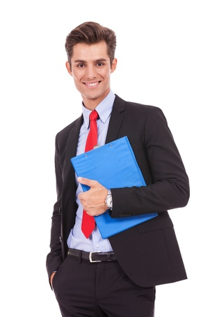 Portrait of happy smiling young business man with clipboard, isolated over white background  Stock Photo - 15738313