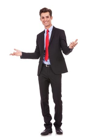 Approachable young business man with open arms to welcome you isolated  photo