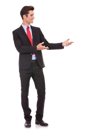 Business man presenting something or inviting you in on white background Stock Photo - 15738095
