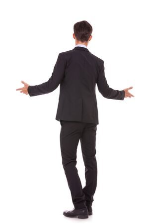 full body back view of a business man welcoming you on white background Stock Photo - 15737991